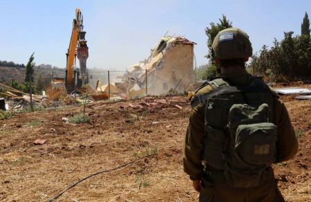 Israeli occupation issues demolition and stop construction orders against 13 Palestinian-owned houses